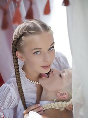 """Two alluring damsels with the face of an angel, pretty braided hair, and delightfully petite bodies dressed in frilly, sheer lingerie and stocki"